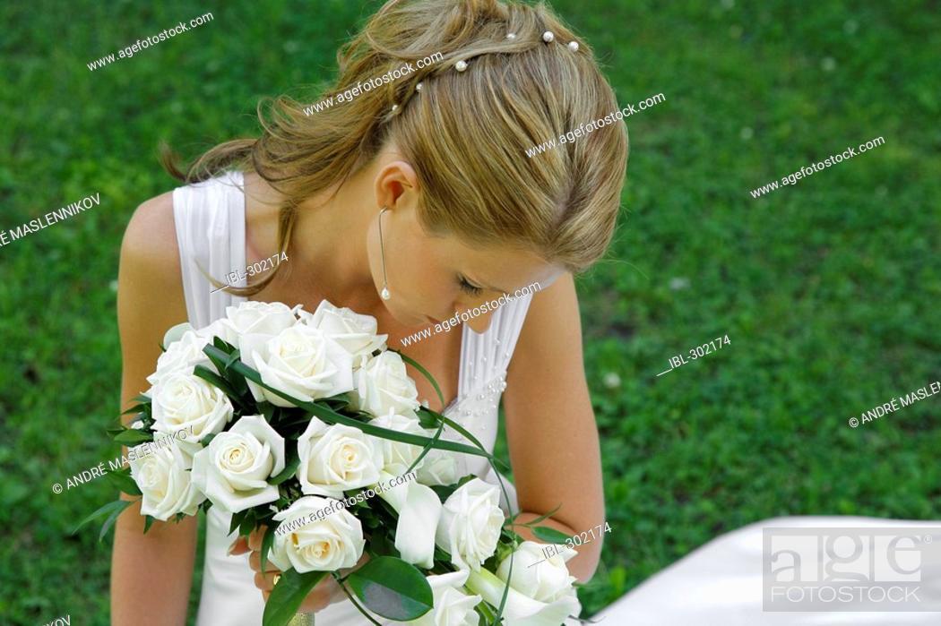 Stock Photo: Bride posing in the park.