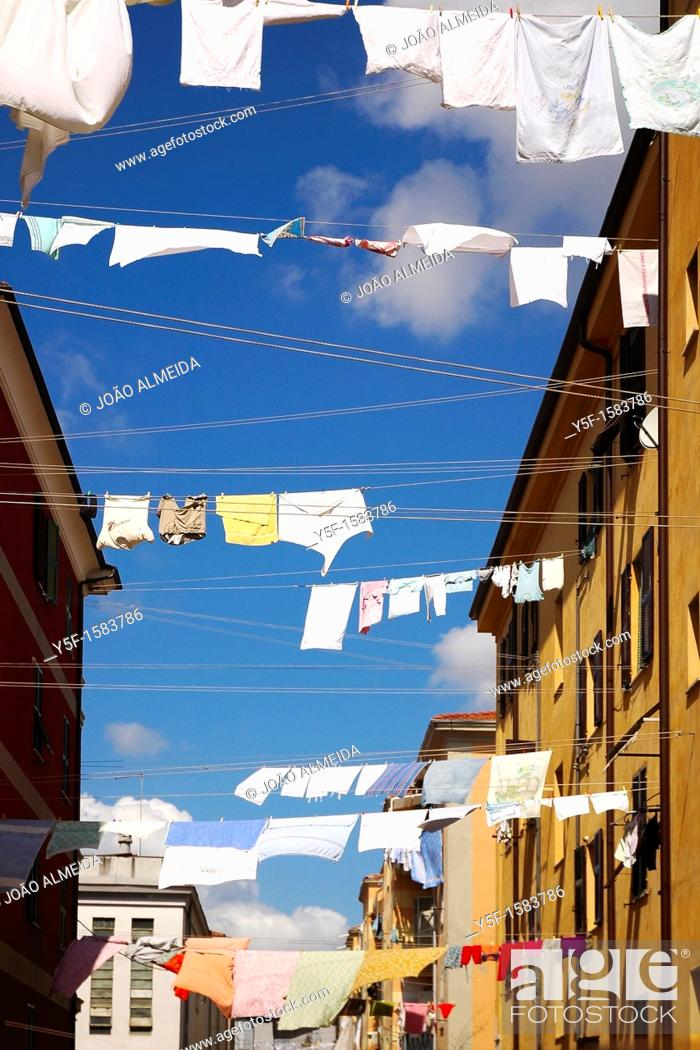 Stock Photo: Clothes drying by the sun at Italian town.
