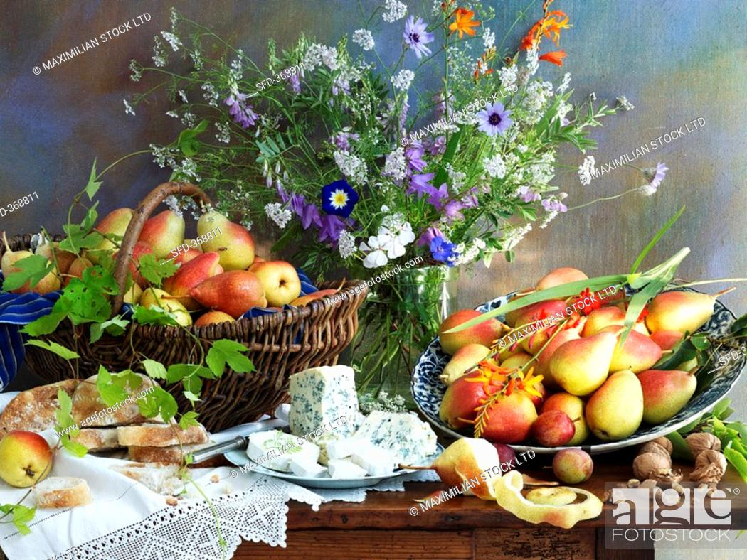 Stock Photo: Still life with pears, cheese and a vase of flowers.