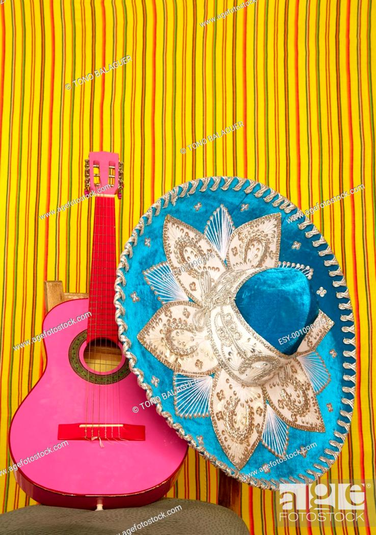Imagen: mariachi embroidery mexican hat pink guitar in striped background.