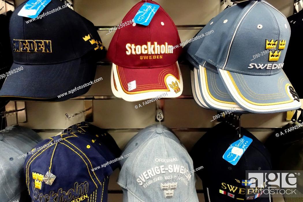 Imagen: STOCKHOLM, SWEDEN Souvenirs, caps and tshirts in tourist shop.