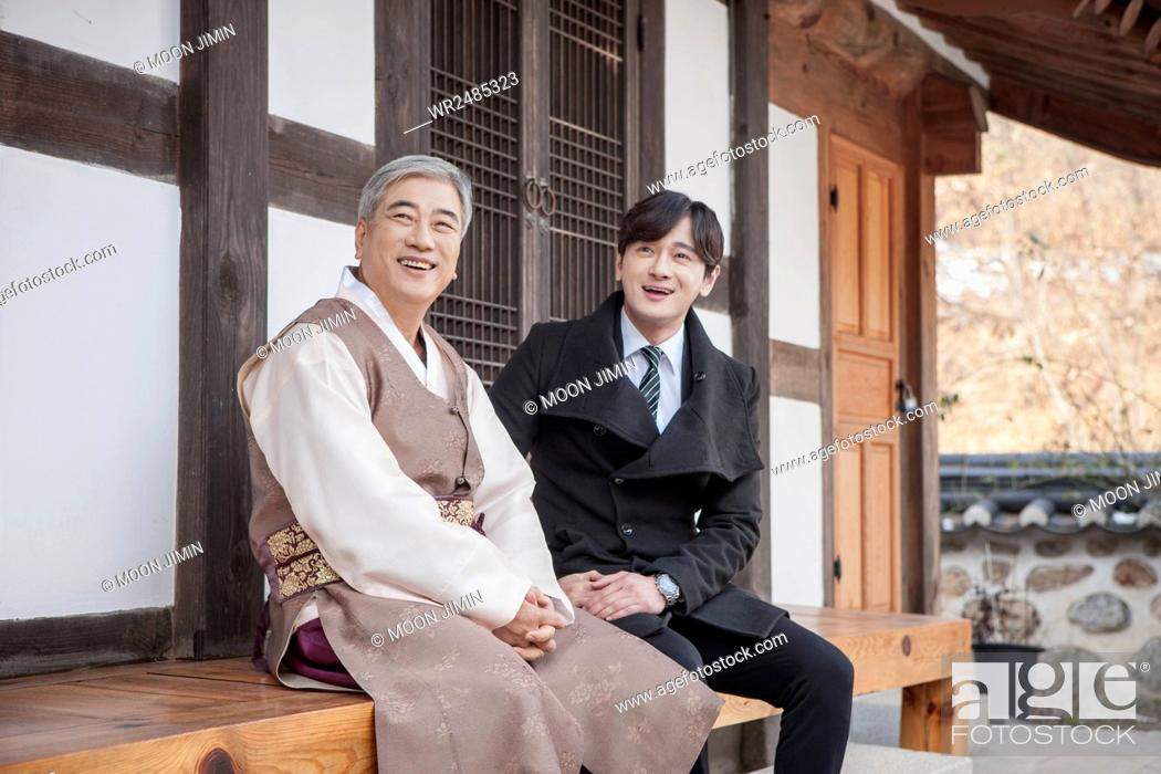 Smiling old man in hanbok and smiling young man in suit stock photo stock photo smiling old man in hanbok and smiling young man in suit publicscrutiny Images