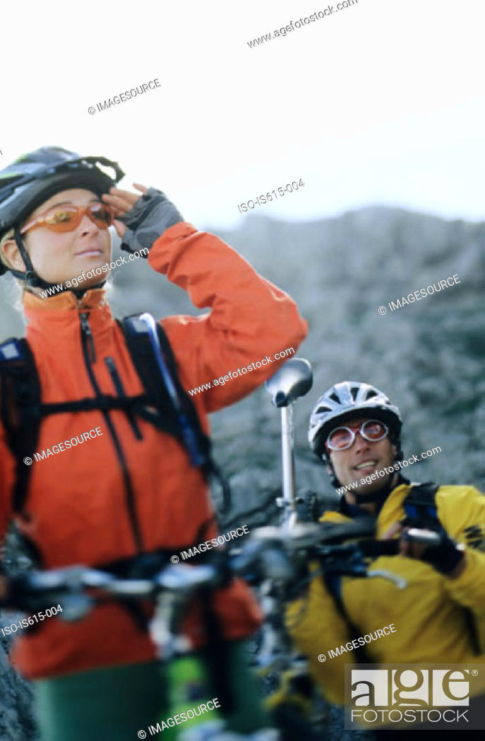 Stock Photo: Cyclists look at route ahead.