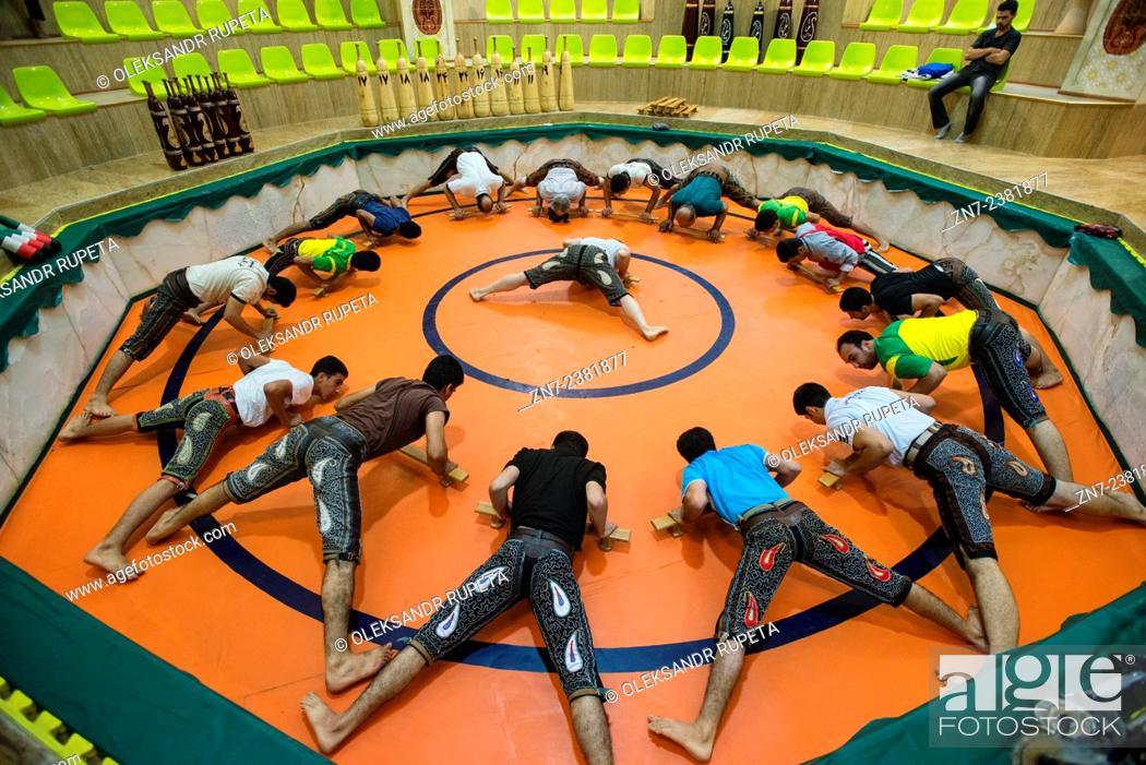 Stock Photo: Pahlevani, Iranian wrestlers, warm up on the beginning of training in zurkhaneh, Esfahan, Iran.