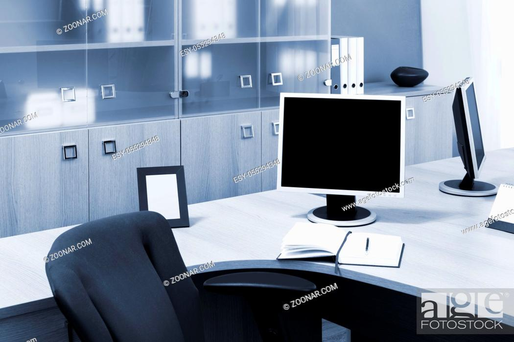 Stock Photo: monitors on a desks in modern office.
