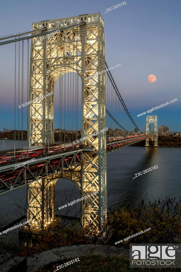 Stock Photo: George Washington Bridge Moon Rising - New York City's landmark, the George Washington Bridge along with a full moon during the blue hour.