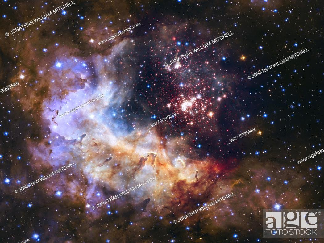 Stock Photo: NASA and ESA are celebrating the Hubble Space Telescope's silver anniversary of 25 years in space by unveiling some of nature's own fireworks - a giant cluster.