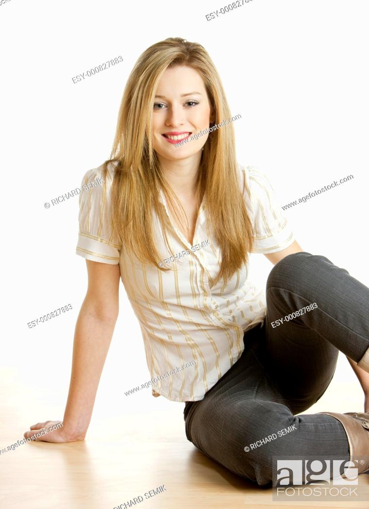 Stock Photo: woman sitting on the floor.