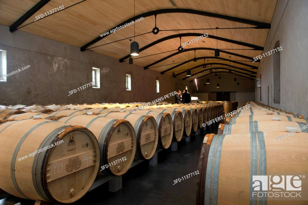 Stock Photo: Barrique barrels in the wine cellar at Chateau Palmer (Bordeaux, France).