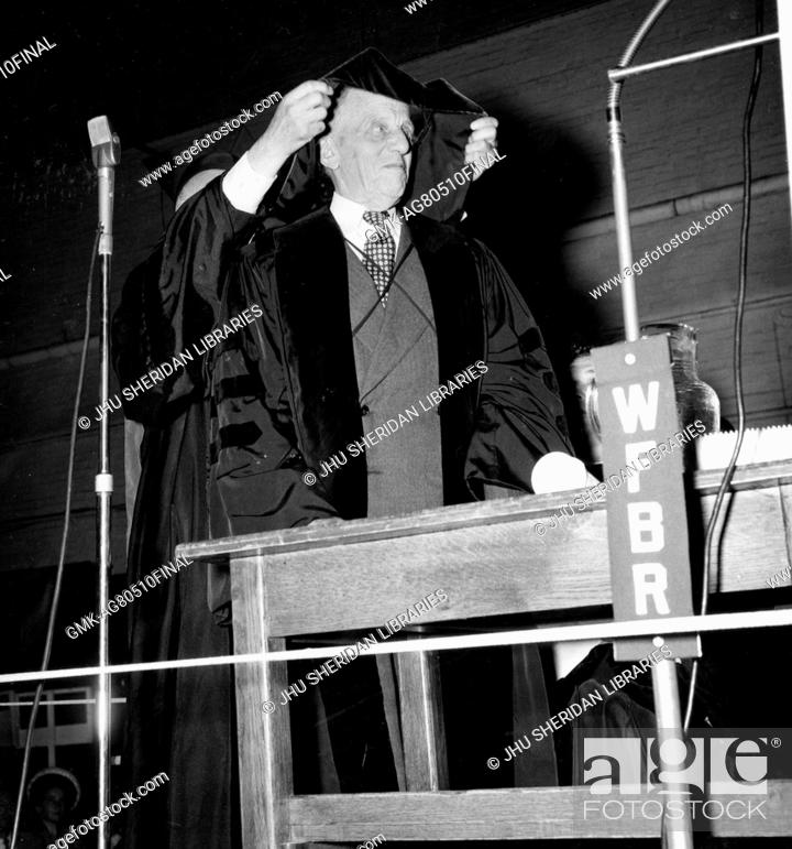 Stock Photo: Candid portrait of American mathematician Luther Pfahler Eisenhart receiving an honorary degree hood at the Johns Hopkins University in Baltimore, Maryland.