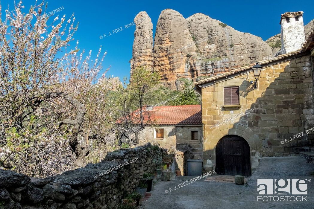 Stock Photo: Aguero Village with rock formation background, Huesca, Aragon, Spain.