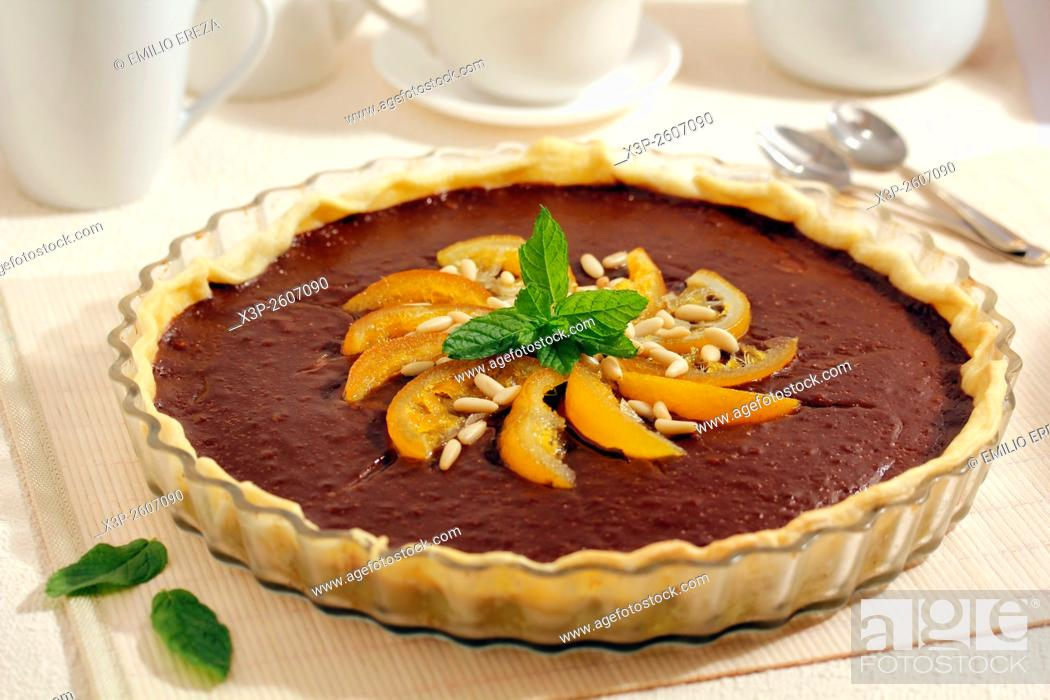 Stock Photo: Chocolate tart with oranges.