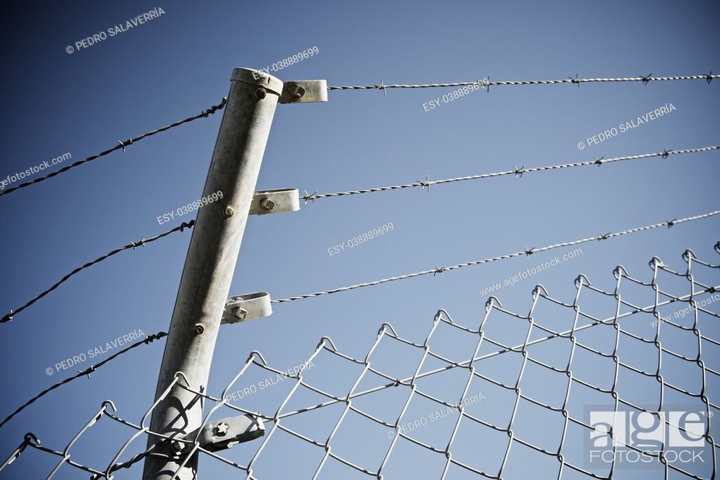 Stock Photo: Barbed wire fence view in Spain.