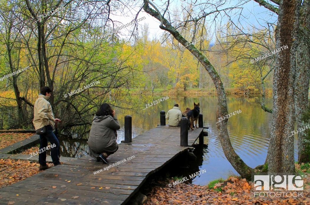Stock Photo: A family enjoys the landscape at the pond of the Bosque de Finlandia (Finnish Forest), where a typical Scandinavian landscape has been recreated between some.