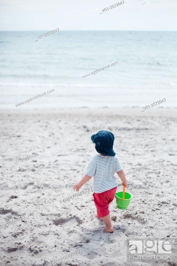 Stock Photo: 2 years old boy playing at the Beach in the Baltic Sea.