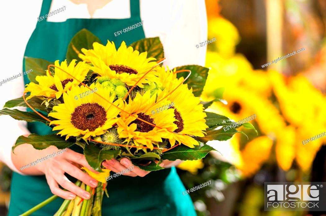 Stock Photo: Bouquet sunflowers flower shop female florist holding.