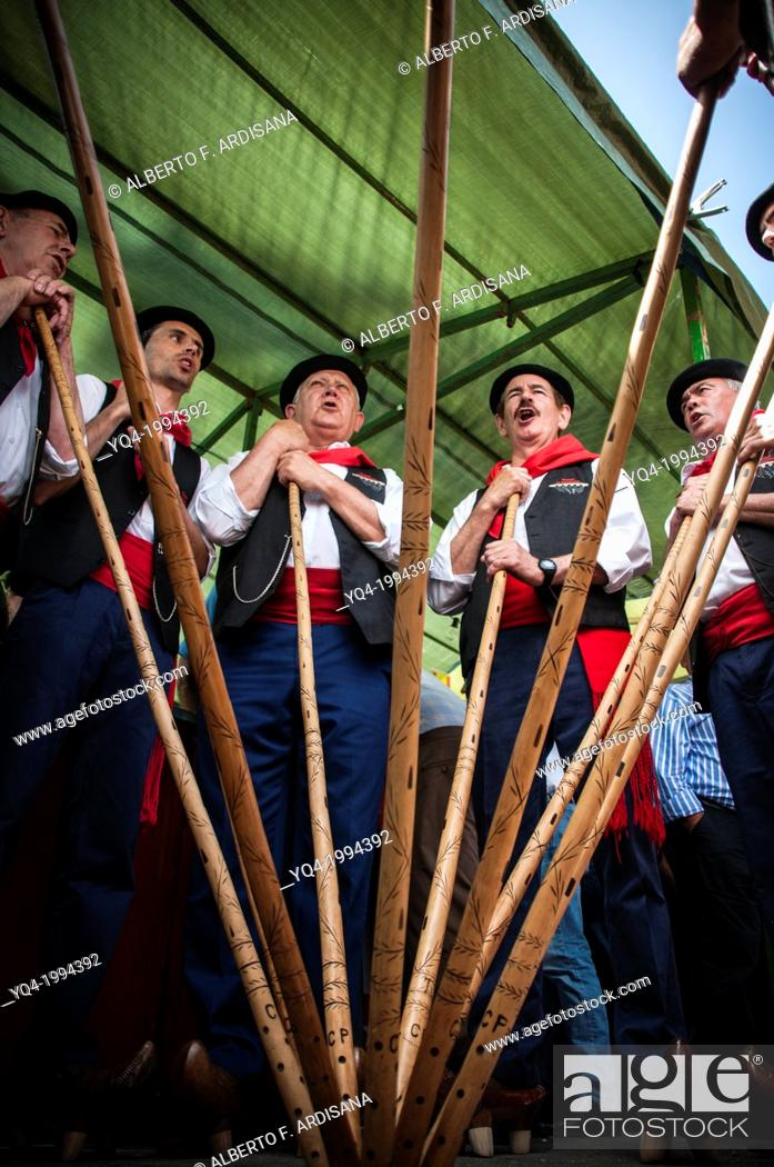 Stock Photo: A group of cantabrian herdsmen, make a circle and join in the center rods, to sing traditional songs, Cantabria, Spain.