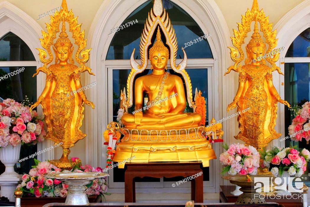 Stock Photo: Golden idols of lord Buddha, outside the main building of Wat Prathat, Pha Sorn Kaew, in Khao Kor, Phetchabun, Thailand.