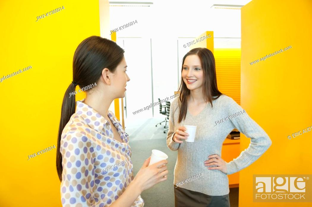 Stock Photo: Businesswomen drinking tea in an office.