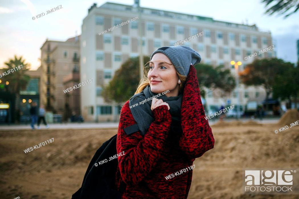 Stock Photo: Spain, Barcelona, young woman on the beach in winter.