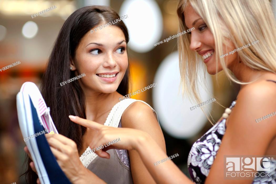 Stock Photo: Young women choosing shoes.