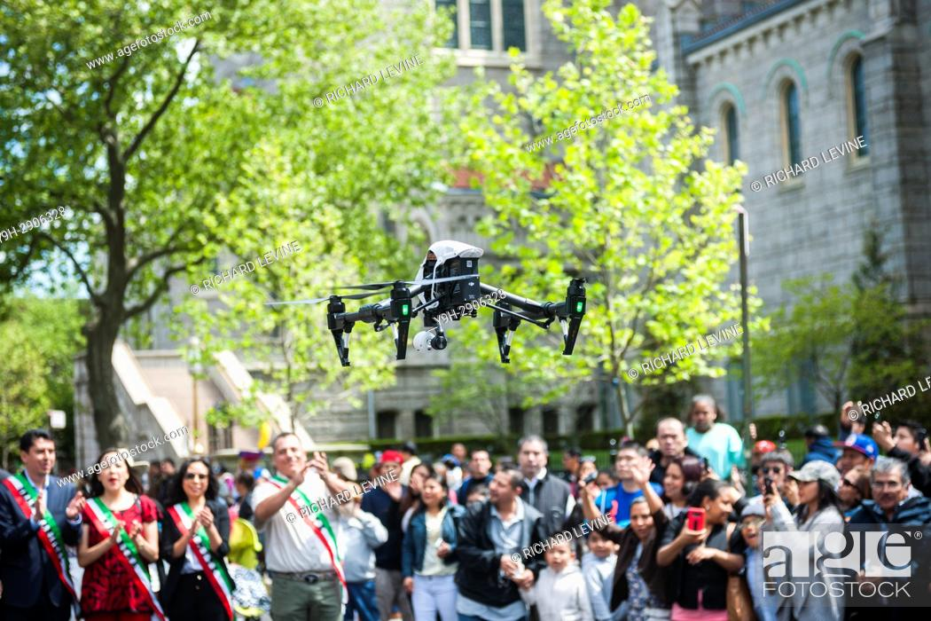 Stock Photo: An operator launches his DJI brand drone in the Sunset Park neighborhood of Brooklyn in New York.