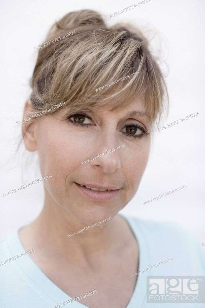 Stock Photo: Portrait of a mature woman smiling.