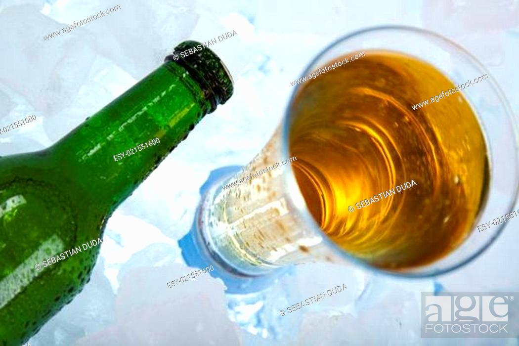 Stock Photo: Still life with bottle and beer.