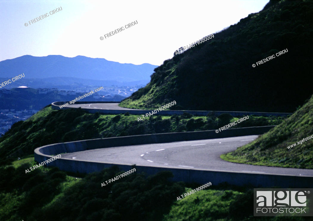 Stock Photo: France, Corsica, road curving around mountain.