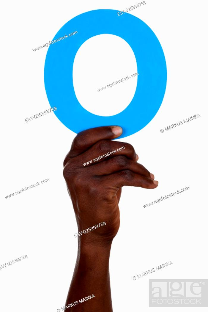 Stock Photo: hand holding the letter o from alphabet number 0 cut.