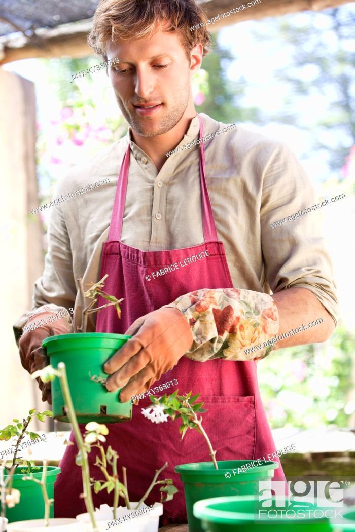 Stock Photo: Man gardening and smiling.