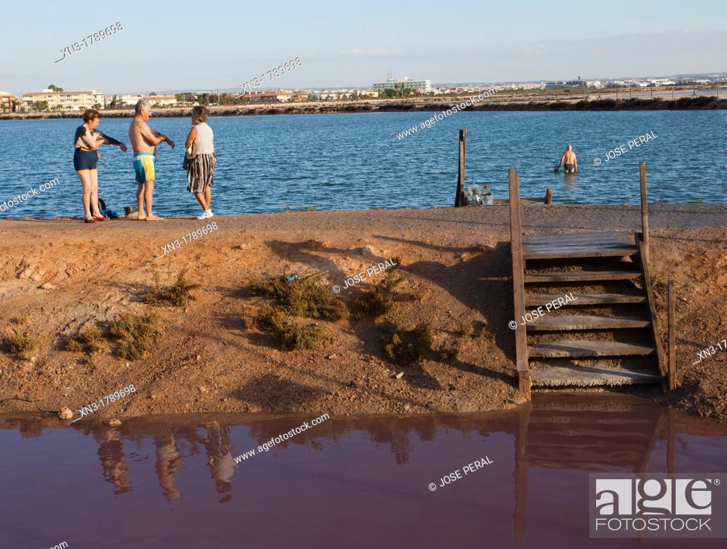 Stock Photo: San Pedro De Pinatar offers visitors the largest area of outdoor mud therapy across Europe  We refer to the mud baths taken in the area known as Las Charcas of.