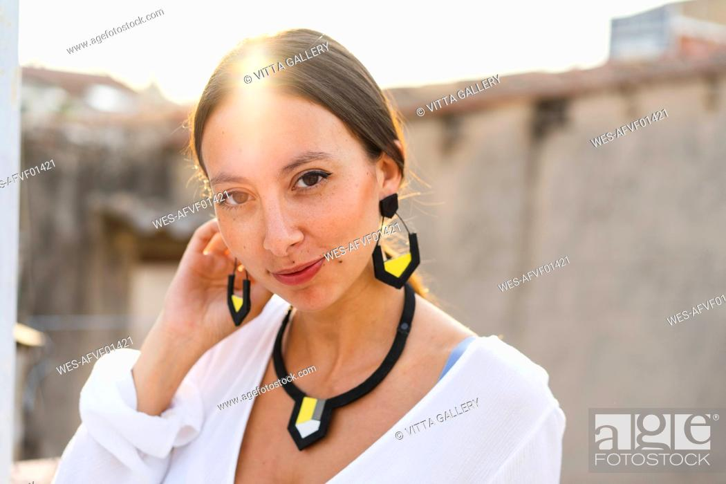 Stock Photo: Portrait of young woman wearing modern necklace and earrings.