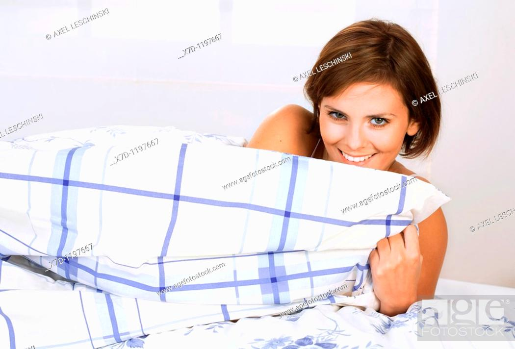 Stock Photo: Woman in bed.