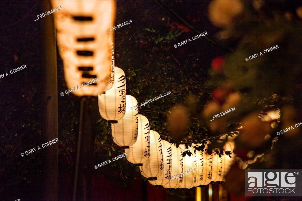 Stock Photo: Row of paper lanterns at Oeshiki Festival Daibo HongyojiTemple in Ikegami, Tokyo, Japan.