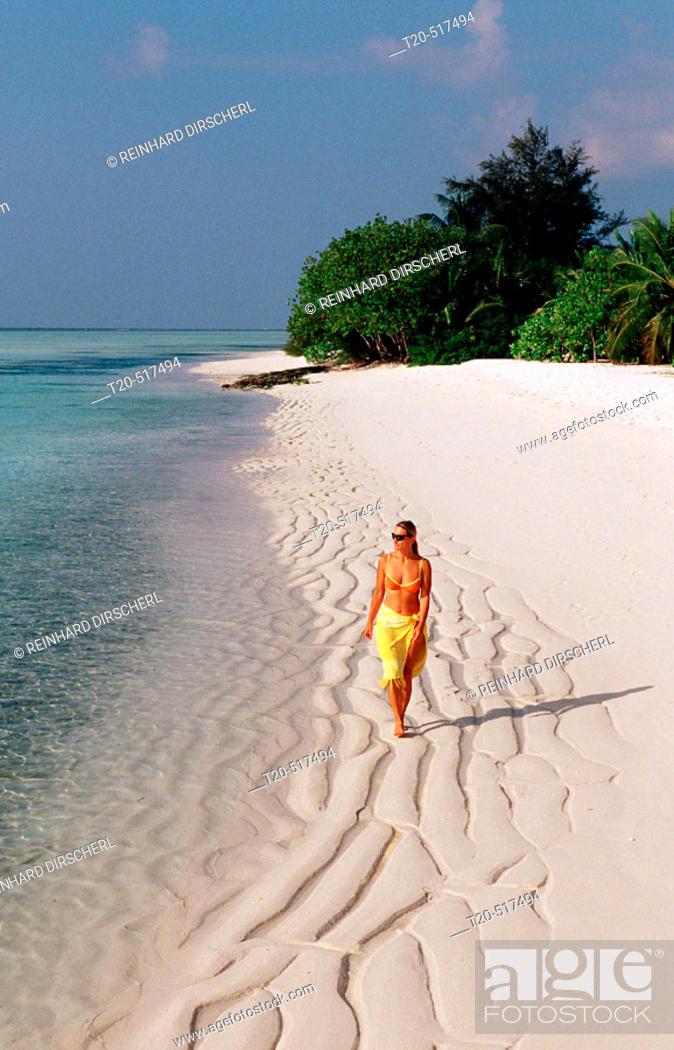 Stock Photo: Woman walks on the beach, Maldives Island, Indian Ocean, Ari Atoll, White Sands Resort.