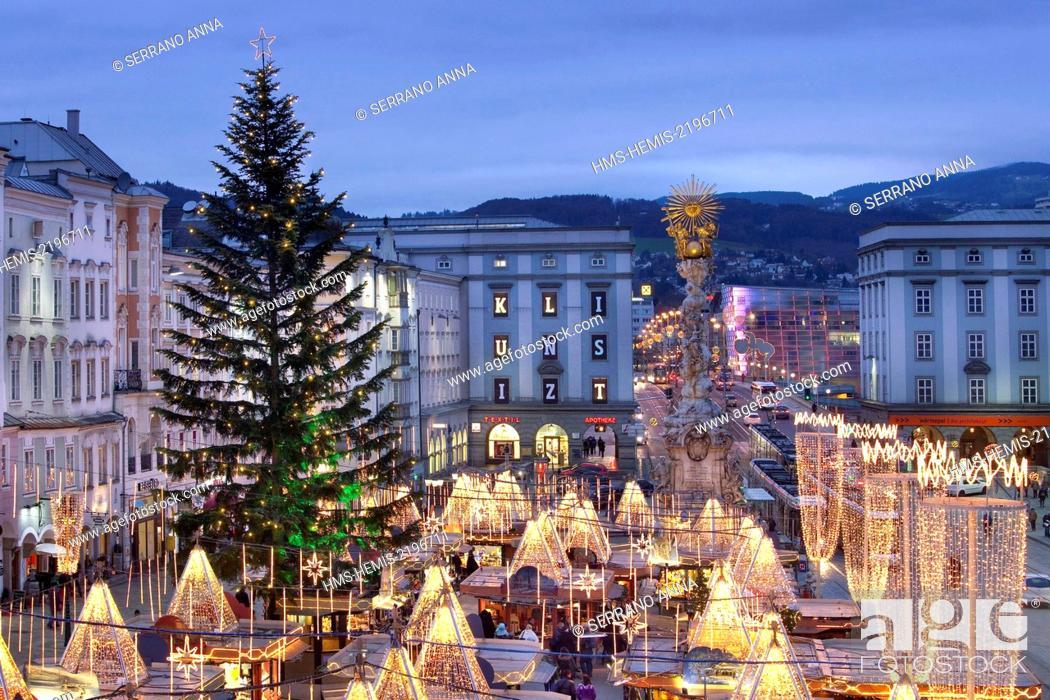 Stock Photo: Austria, Upper Austria, Linz, Hauptplatz Christmas Market at dusk.