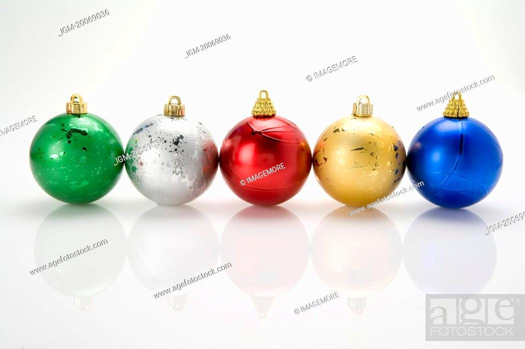 Stock Photo: A row of Christmas baubles.
