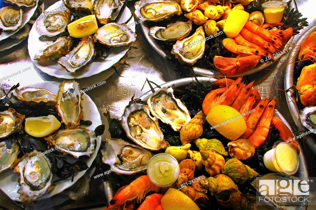 Stock Photo: Seafood (oysters, shrimps and whelks) at the Marché des Capucins market, Bordeaux, Gironde, Aquitaine, France.