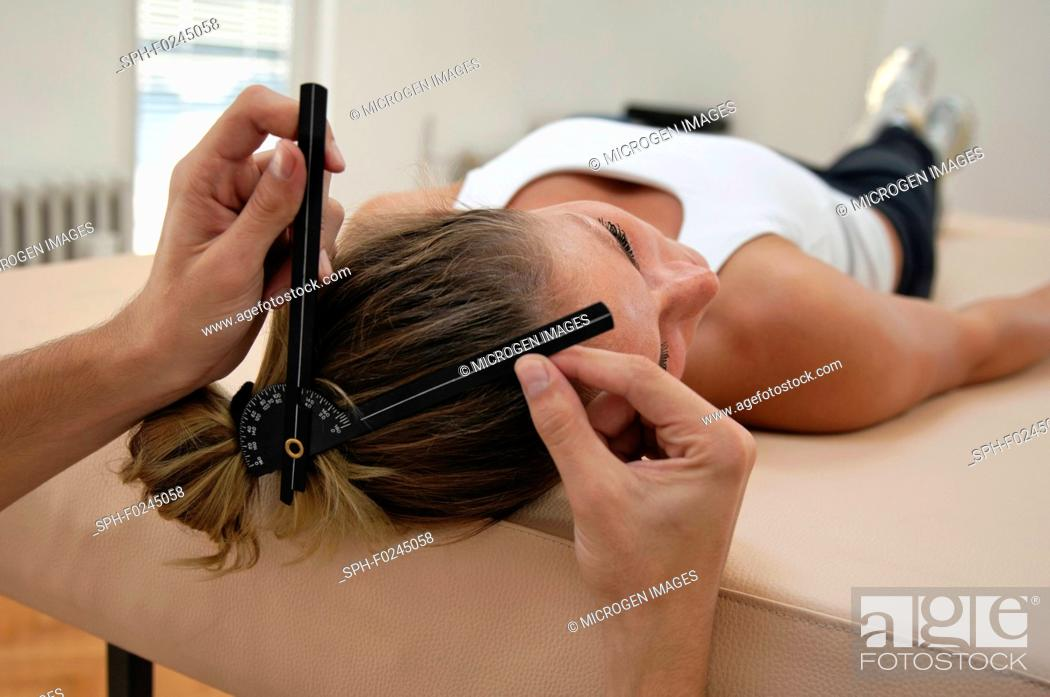 Stock Photo: Cervical goniometry, physiotherapist and young female.