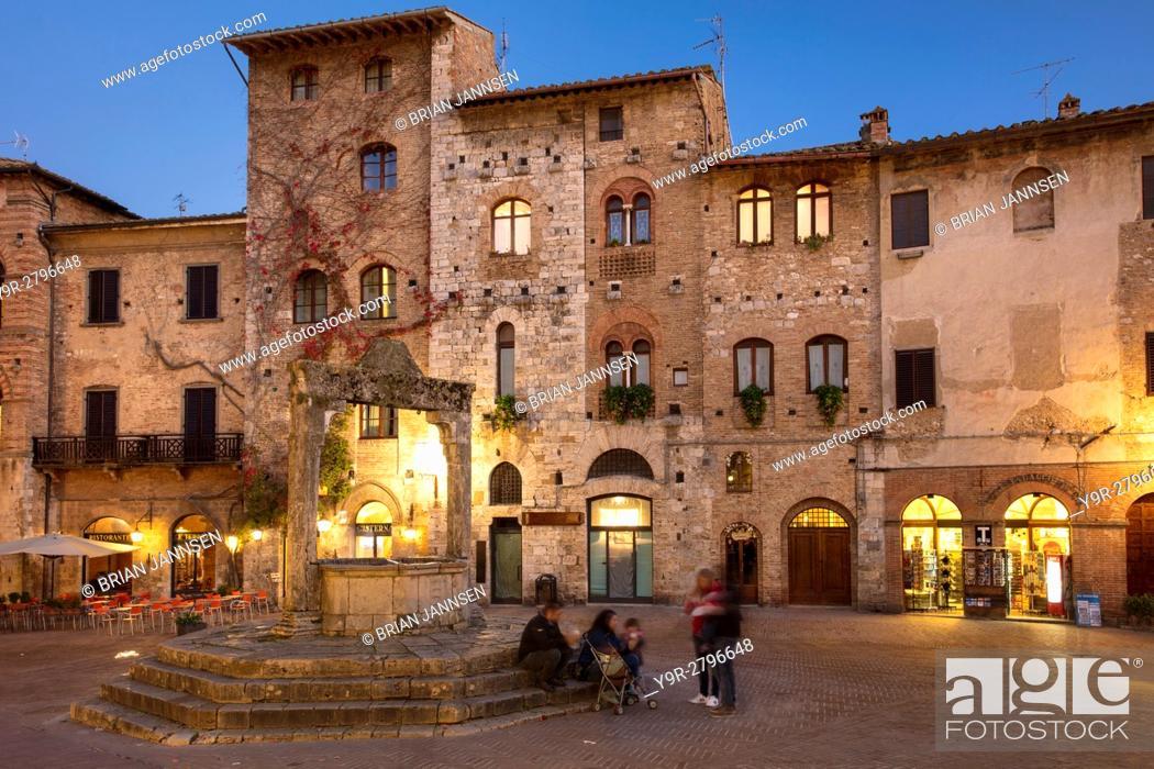 Stock Photo: Twilight in Piazza della Cisterna, San Gimignano, Tuscany, Italy.