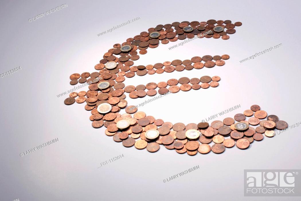 Stock Photo: European Union coins arranged into a Euro symbol.