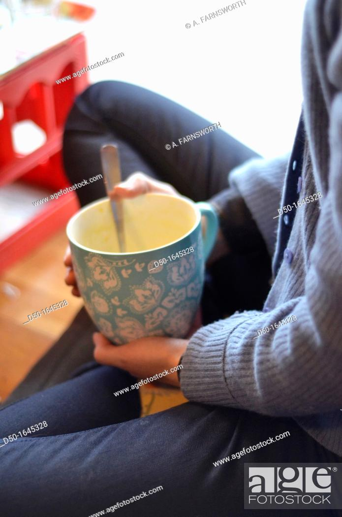 Stock Photo: Girl at a cafe with large bowl of soup, Stockholm, Sweden.