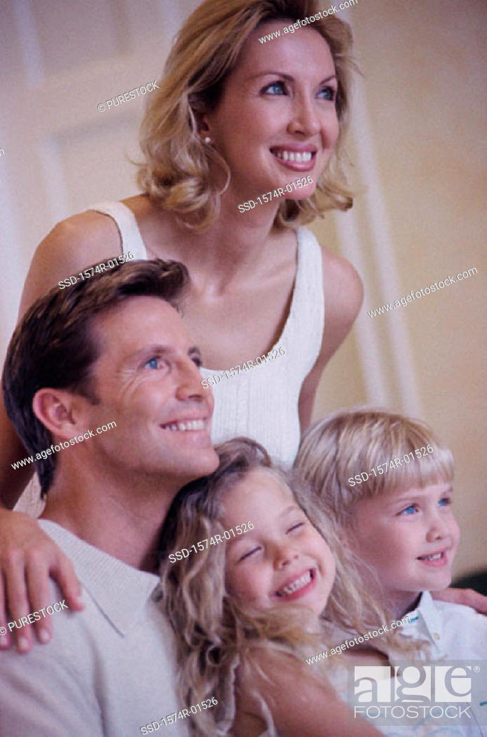 Stock Photo: Parents and their children looking ahead.
