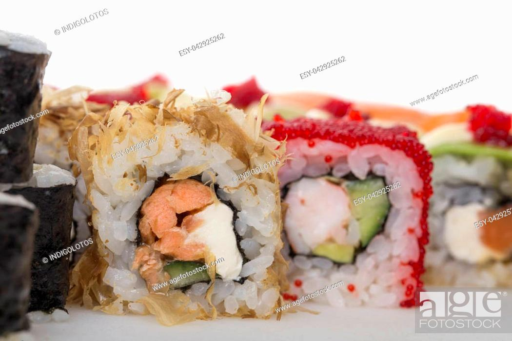 Stock Photo: Crispy sushi roll with salmon and cream cheese. Macro. Photo can be used as a whole background.