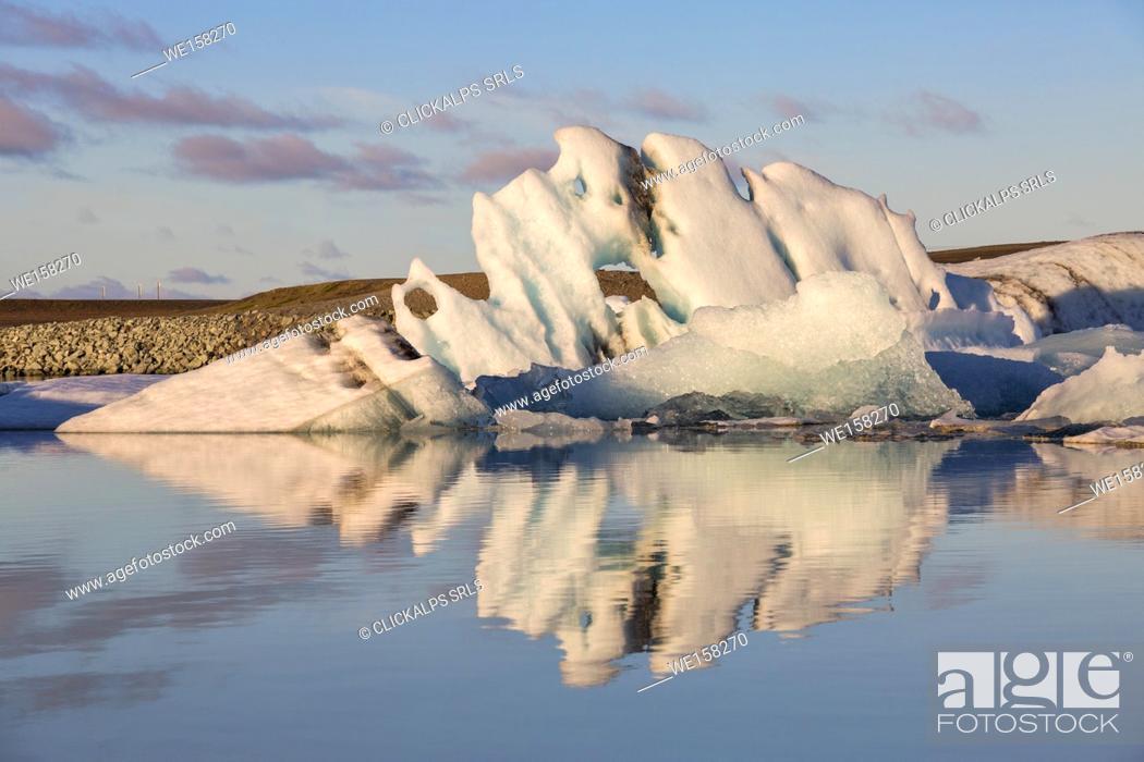 Stock Photo: Iceberg reflection in Jokulsarlon Glacier Lagoon during a sunrise, Austurland, Eastern Iceland, Iceland.