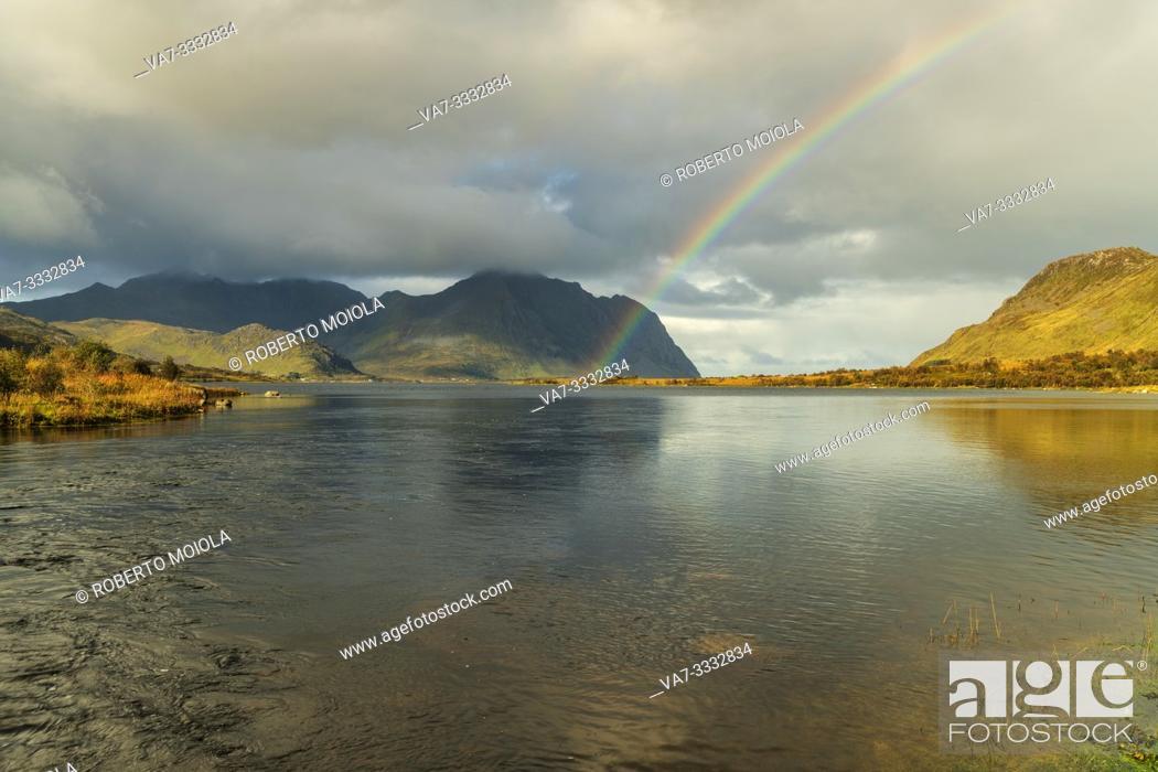 Stock Photo: Rainbow above the fjord, Bostad, Vestvagoy, Nordland, Lofoten Islands, Norway.