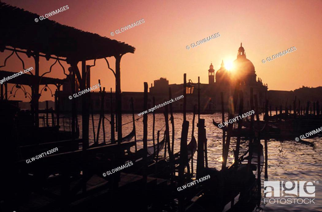 Stock Photo: Gondolas moored at a dock, Italy.