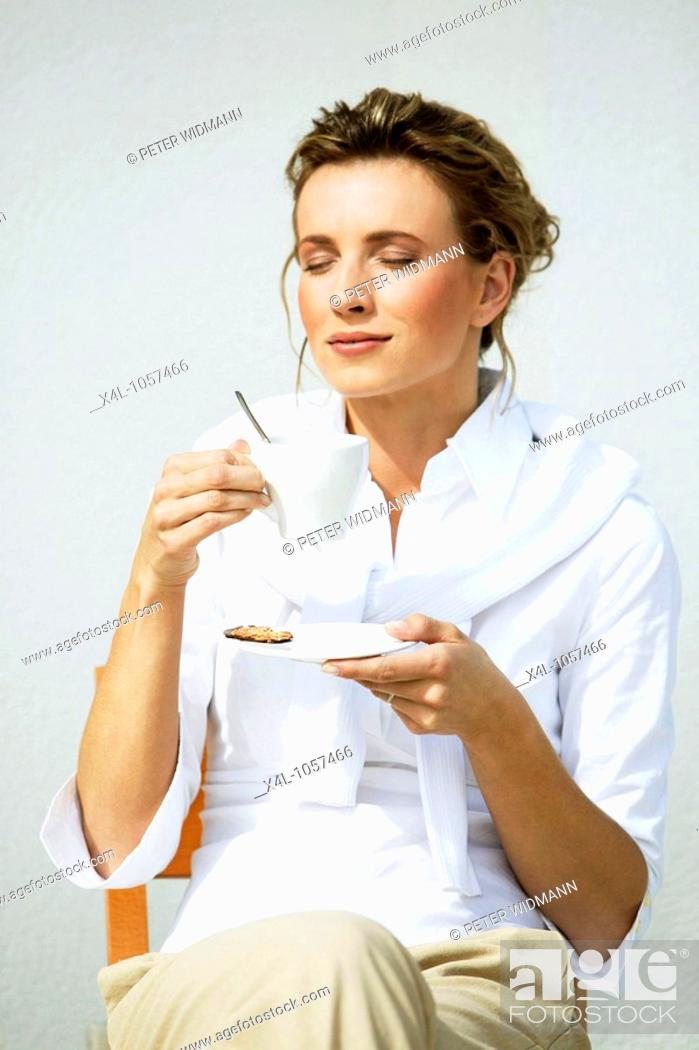 Stock Photo: Woman drinking a cup of coffee.