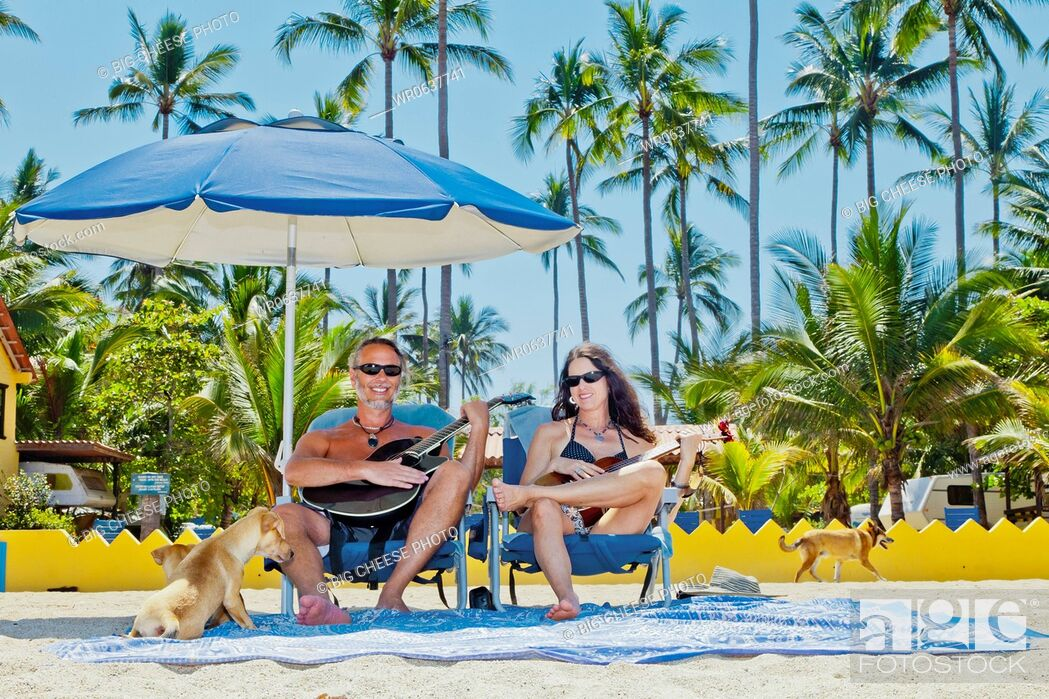 Stock Photo Hy Man And Woman In Beach Chairs With Guitars Dogs